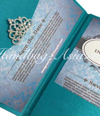 luxury wedding envelope with crown brooch