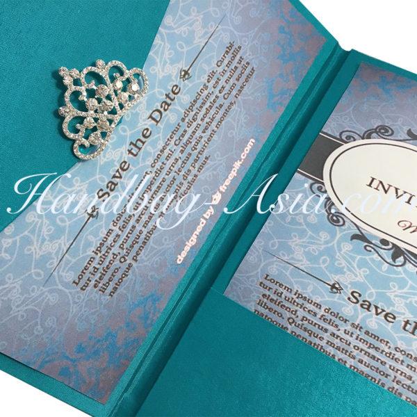 luxury wedding envelope with crown brooch