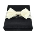 Black hinged lid box with ivory silk bow embellishment