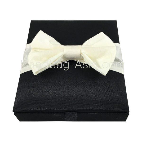Black hinged lid box with ivory silk bow embellishment
