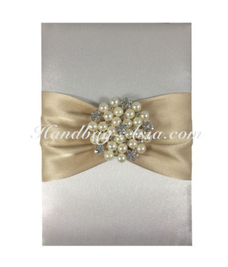 invitation pad with pearl brooch