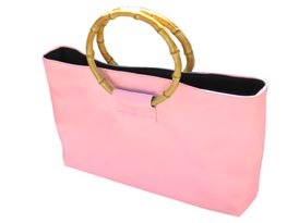 pink silk bag with round bamboo handle