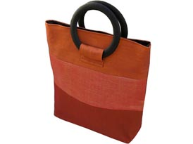 Orange silk bag with round hardwood handle