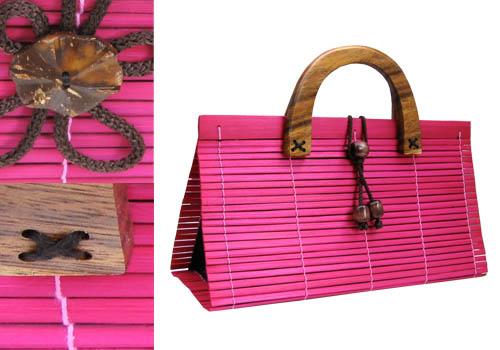 pink bamboo handbag with wooden handle