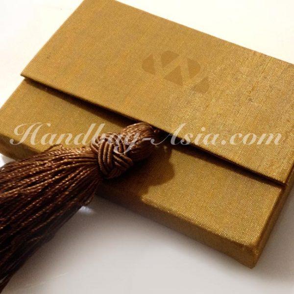 golden silk name-card holder with brown tassel