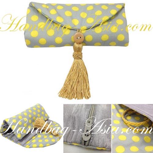 polkadot jewellery roll with tassel decoration