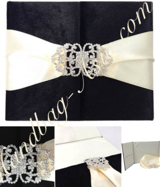 black velvet invitation with rhinestone clasp