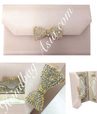 blush pink silk envelope with crystal bow for sweet sixteen and wedding invitation cards