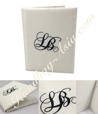 Monogram embroidered wedding book-fold invitation