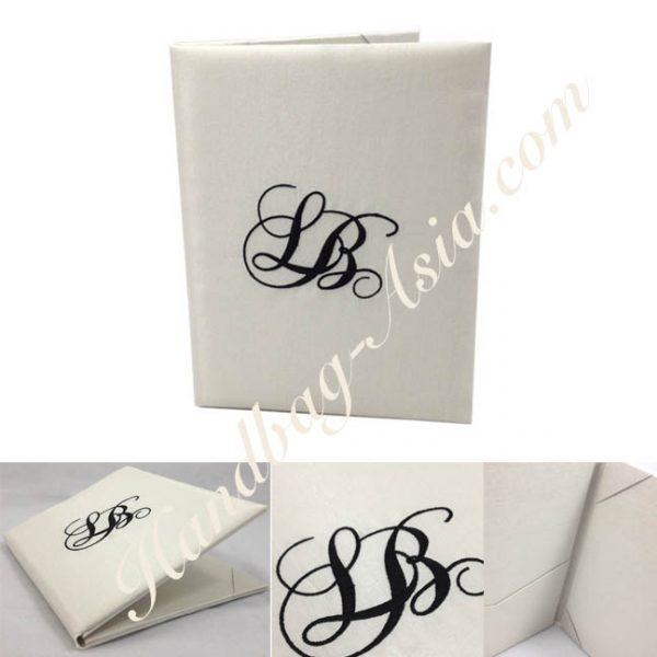 Monogram embroidered wedding book-fold invitation