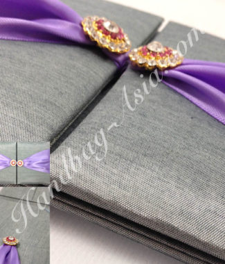Luxury silver wedding invitation with brooches