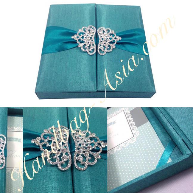 Teal wedding invitation box with crystal crown pair brooch