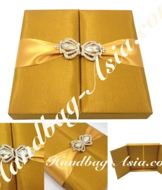 Impressive Silk Box Covered With Golden Faux silk, Embellished With Gold Plated Rhinestone Crown Brooches