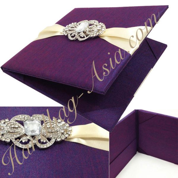 Luxury folio invitation in purple with vintage brooch