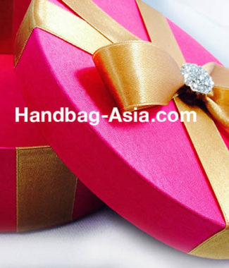 Round Pink Silk Box With Golden Bow With Brooch