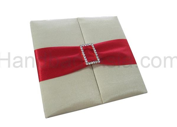 Embellished ivory wedding folder with red ribbon and buckle