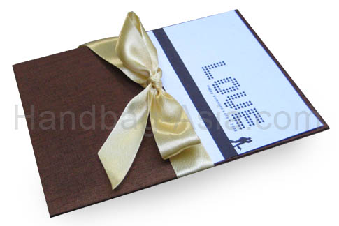 dark brown silk pad for cards with golden bow embellishment