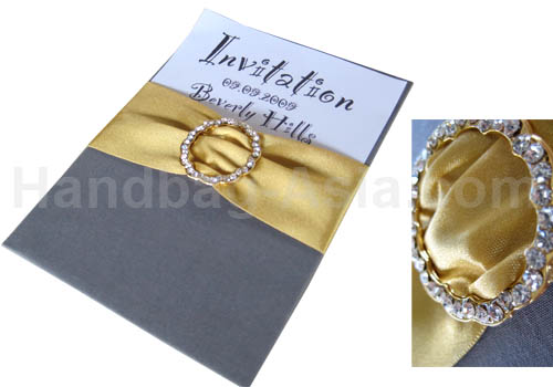 silk invitation pad with golden buckle and ribbon