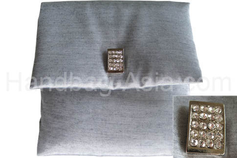 Silver silk envelope with padding and crystal button