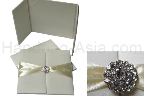ivory wedding folder with crystal brooch