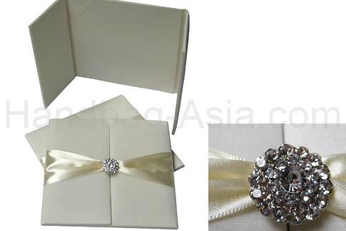 ivory wedding folder with crystal brooch
