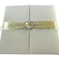 Heart buckle embellished wedding folder in ivory with pockets for cards
