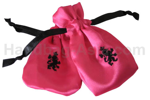 Pink satin drawstring bag with black embroidery
