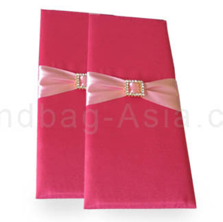pink silk baker with buckle embellishment