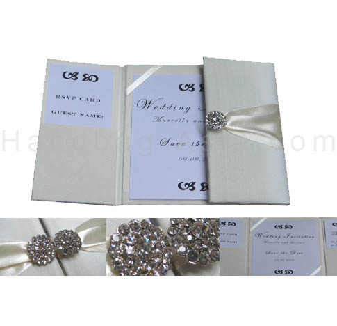 Embellished ivory wedding invitations with brooches