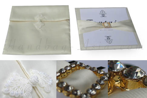 Embellished silk envelope with pad and buckle