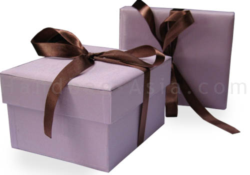 Orchid color silk box with removable lid and brown ribbon bow