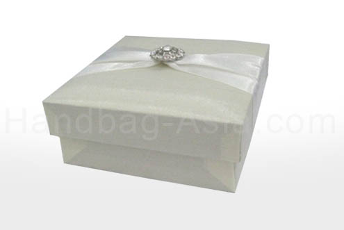 Ivory silk favor box with embellishment