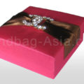 Luxury fuchsia pink silk gift box for wedding favor and gift packaging featuring rhinestone brooch