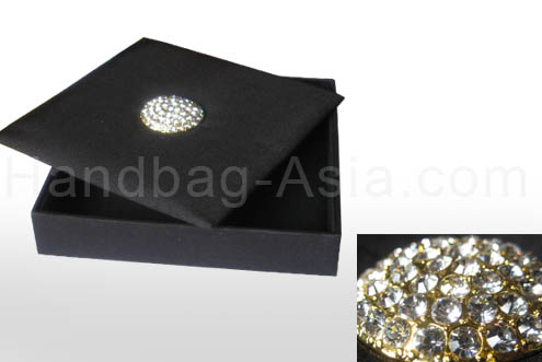 Black silk box with brooch embellishment and pocket holder