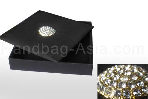 Black silk box with brooch embellishment and pocket holder