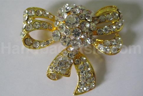 big golden rhinestone brooch