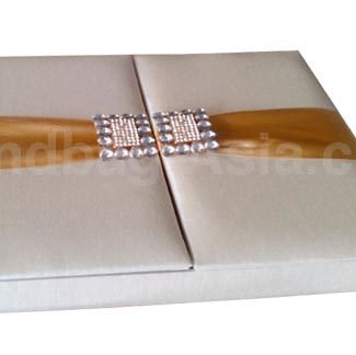 Luxury wedding invitation box in ivory with golden ribbon