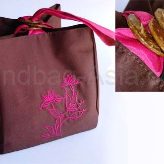brown silk bag with fuchsia pink embroidery
