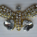 Cute gold plated rhinestone butterfly brooch with clip back and heart crystal