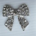 Silver bow embellishment with crystal