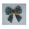 golden crystal brooch with aqua rhinestones