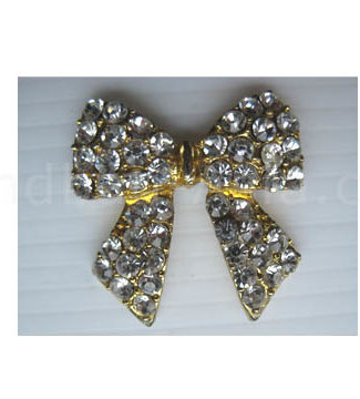 Crystal bow in gold