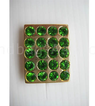 crystal button with green rhinestones