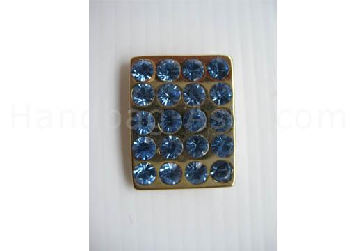 golden crystal button with aqua rhinestones