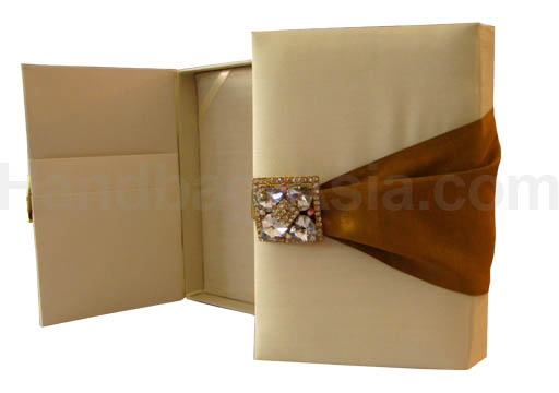 Cream and gold wedding box with crystal brooches and silk cover
