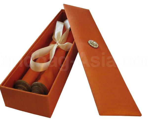 orange silk box with scroll invitation