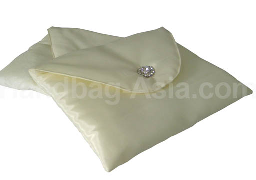 ivory silk envelope with round flap and crystal button