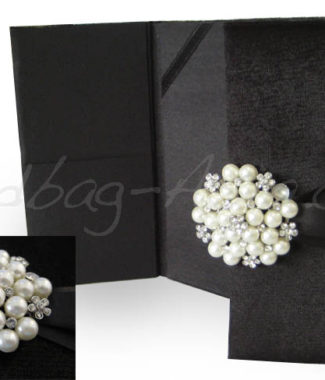 Black velvet invitation with pearl brooch