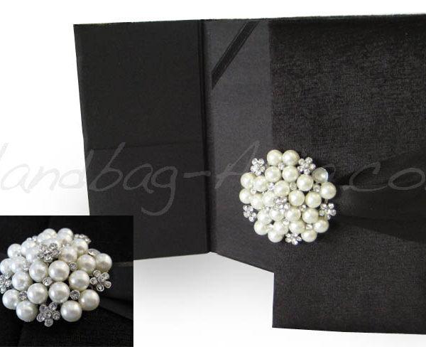 Black velvet invitation with pearl brooch