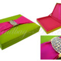 green and fuchsia pink wedding box that is embellished